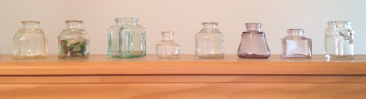 Glass antique ink wells woned by Sue Becker Grapher